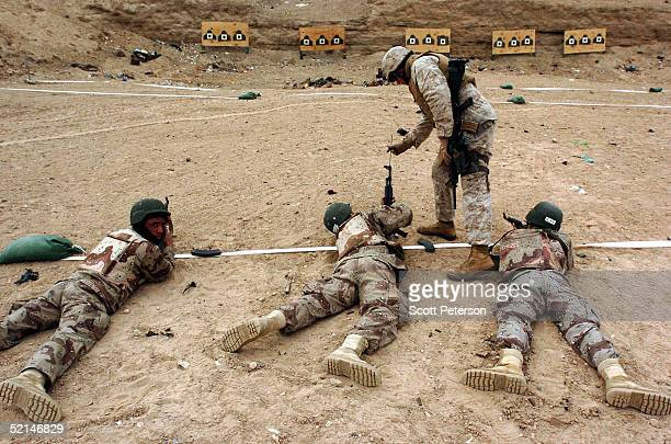 Iraqi army soldiers receive marksmanship training on February 6 2005 by US Marines of the 3rd Battalion 5th Marines at a firing range in Fallujah...