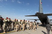 Iraqi army soldiers stand before boarding a military plane in Baghdad to fly to a conference on fighting the Islamic State group attended by Iraq's...