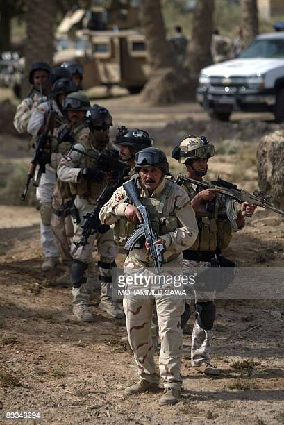 Iraqi Army Special Forces arrive to search a house after receiving a tip on possible presence of weapons in the AlTaliaa village near Diwaniyah 150...