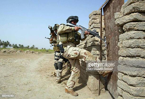 Iraqi Army Special Forces break into a house after receiving a tip on possible presence of weapons in the AlTaliaa village near Diwaniyah 150 km...