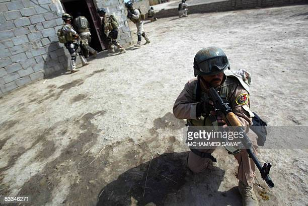 Iraqi Army Special Forces search a house after receiving a tip on possible presence of weapons in the AlTaliaa village near Diwaniyah 150 km south of...