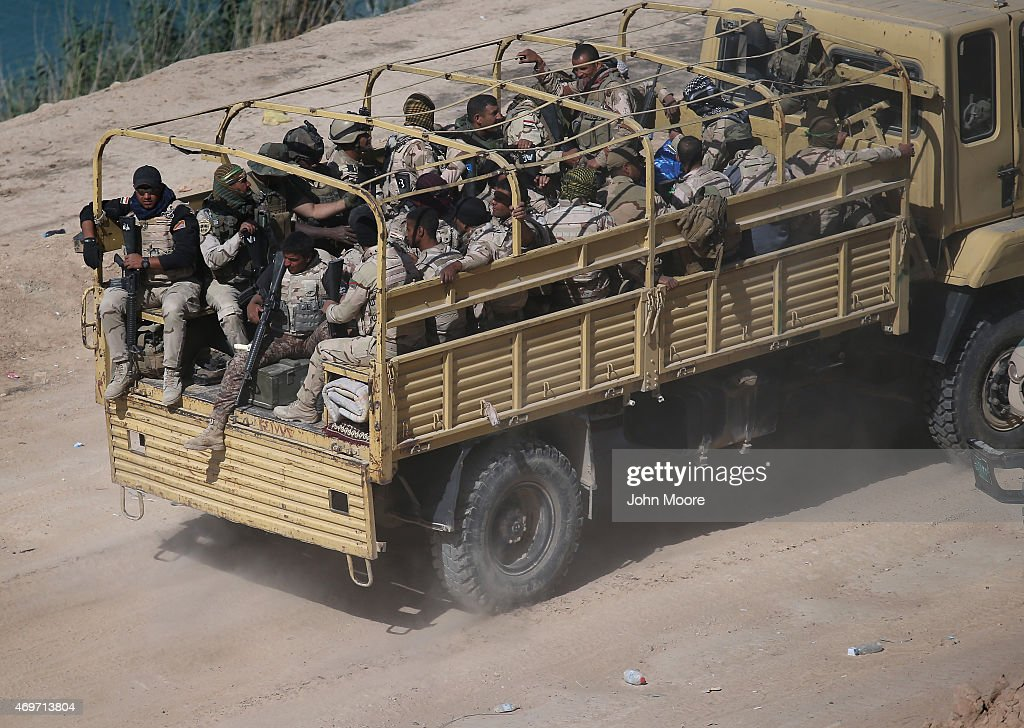 Iraqi Army troops move along the frontline April 14 2015 near AlKarmah in Anbar Province Iraq Iraqi government forces are assaulting ISIL fighters on...