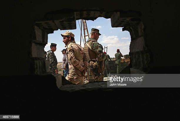 Iraqi Army troops stand in a field headquarters behind the frontline with ISIL on April 14 2015 near AlKarmah in Anbar Province Iraq Iraqi government...