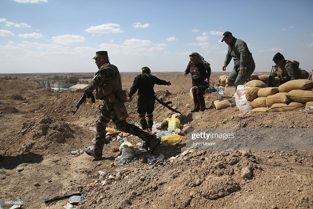 Iraqi Army troops take positions on the frontline with ISIL on April 14 2015 near AlKarmah in Anbar Province Iraq Iraqi government forces are...