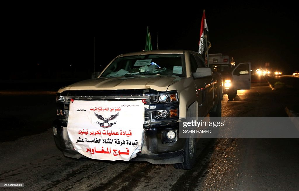 Iraqi army vehicles are seen headed towards Makhmur, about 280 kilometres (175 miles) north of the capital Baghdad, on February 11, 2016. The Iraqi army is deploying thousands of soldiers to a northern base in preparation for operations to retake the Islamic State (IS) group's hub of Mosul, according to officials, as IS still holds Fallujah, east of Ramadi, and Mosul, Iraq's second city that is located in the north. / AFP / SAFIN HAMED