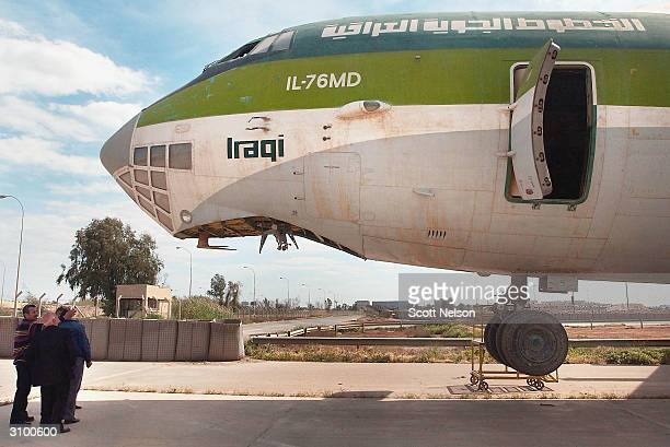 Iraqi aviation engineers conduct an inspection of damaged Iraqi Airways aircraft at the Baghdad International Airport on March 16 in Baghdad Iraq...