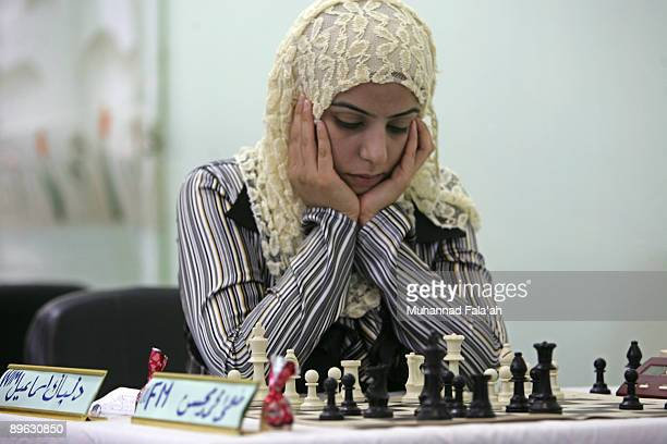 Iraqi chess player Delbak Ismail contemplate her next move during the Iraq chess championship on August 6 2009 in Baghdad Iraq Iraqi chess players...