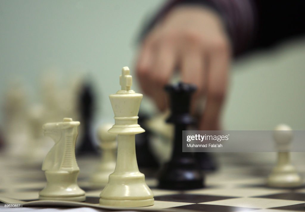 Iraqi chess player Maha Leith moves a piece during the Iraq chess championship on August 6 2009 in Baghdad Iraq Iraqi chess players from all over...