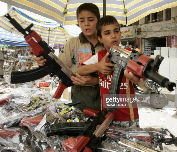 Iraqi children play with toy guns, model Pictures   Getty ...