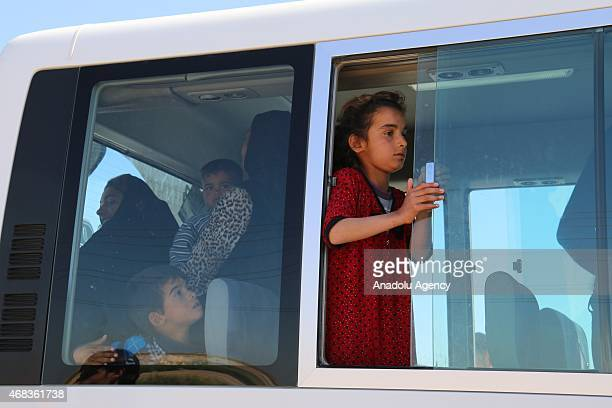 Iraqi children seen in a car as they wait at a checkpoint to arrive Tikrit after Iraqi forces including soldiers police officers Shiite militias and...