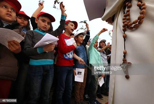 Iraqi children sing as Christians gather at the SaintJoseph church in Arbil the capital of the autonomous Kurdish region of northern Iraq on March 28...