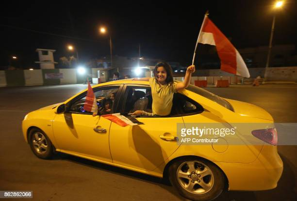 Iraqi children wave their national flag as they celebrate in the city of Kirkuk on October 18 after Iraqi government forces retook almost all the...
