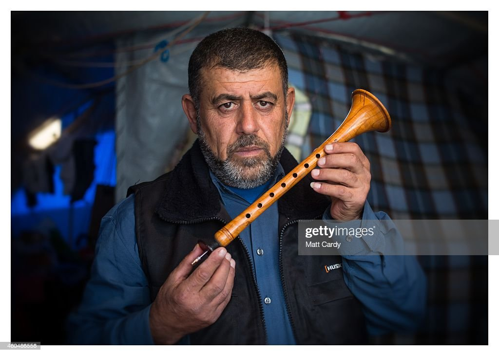 Iraqi Christian Anwar Nassir poses for a photograph in his tent erected in the grounds of Mazar Mar Eillia (Mar Elia) Catholic Church, that has now become home to hundreds of fellow Iraqi Christians who were forced to flee their homes - many with less than an hour to do so - as the Islamic State advanced earlier this year, on December 13, 2014 in Erbil, Iraq. Asked, after his family what was the one thing he could not leave behind as ISIL advanced on his home, the drum maker from Qaraqosh said his musical instrument. He had to leave most of them behind as, after he made sure his family had left safely, he only could travel on a small motorbike. 'They can take whatever they want, but I pray that they will have left my instruments.' he said. Although the autonomous Kurdistan region of Northern Iraq was already a refuge for an estimated 250,000 Syrian refugees, since the Islamic State began its onslaught on Iraq in June, Kurdistan has also taken in a more than one and a half million displaced people. Many have been placed in purpose-built refugee camps but the huge numbers mean thousands of others are forced to live in un-finished buildings or inadequate, makeshift shelters and as winter in the region closes in, there are growing concerns for the welfare of the refugees who, while their homes are still in ISIL controlled territory, have no realistic prospect of returning to them.
