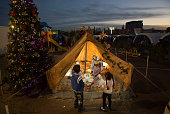 Iraqi Christian children look at a nativity scene that is displayed in a tent erected in the grounds of Mazar Mar Eillia Catholic Church in Ankawa...