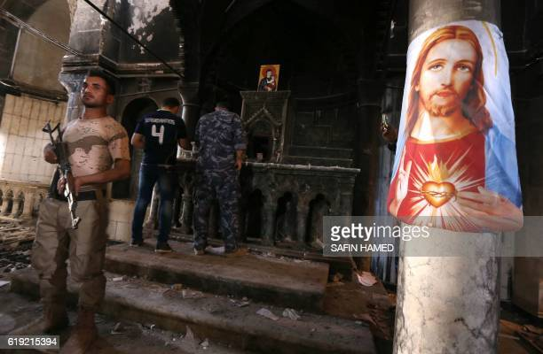 Iraqi Christian forces inspect the damage at the Church of the Immaculate Conception on October 30 2016 in the town of Qaraqosh 30 kms east of Mosul...