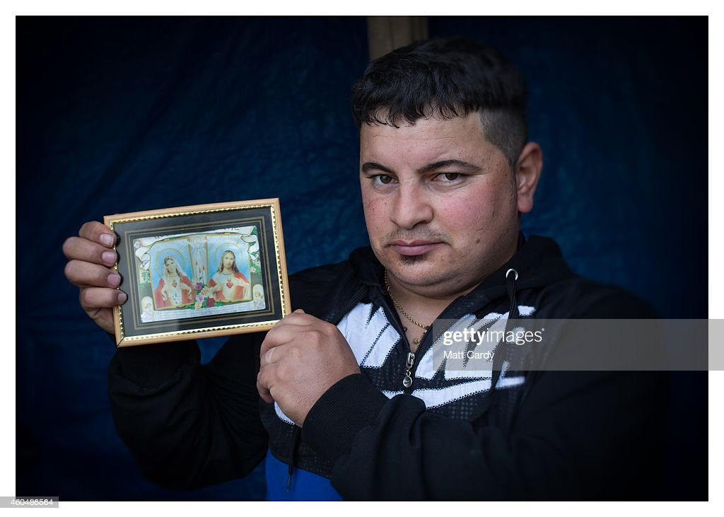 Iraqi Christian, Khidhir Badry, poses for a photograph in his tented home erected in the grounds of Mazar Mar Eillia (Mar Elia) Catholic Church, that has now become home to hundreds of fellow Iraqi Christians who were forced to flee their homes - many with less than an hour to do so - as the Islamic State advanced earlier this year, on December 13, 2014 in Erbil, Iraq. Asked, after his family what was the one thing he could not leave behind as ISIL advanced on his home, the tractor driver from Qaraqosh said his picture of Jesus and Mary. Although the autonomous Kurdistan region of Northern Iraq was already a refuge for an estimated 250,000 Syrian refugees, since the Islamic State began its onslaught on Iraq in June, Kurdistan has also taken in a more than one and a half million displaced people. Many have been placed in purpose-built refugee camps but the huge numbers mean thousands of others are forced to live in un-finished buildings or inadequate, makeshift shelters and as winter in the region closes in, there are growing concerns for the welfare of the refugees who, while their homes are still in ISIL controlled territory, have no realistic prospect of returning to them.