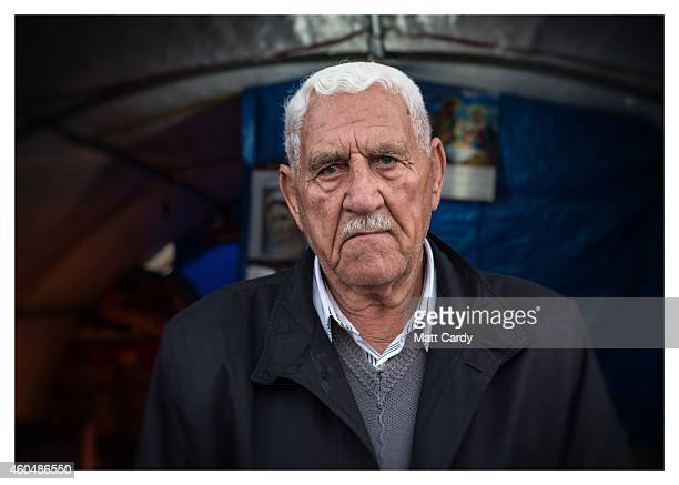 Iraqi Christian Rafo Polis poses for a photograph in his tented home erected in the grounds of Mazar Mar Eillia Catholic Church that has now become...