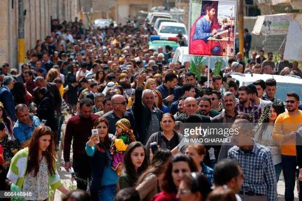 Iraqi Christian residents from Qaraqosh some 30 kilometres east of Mosul take part in a parade on April 9 as Christians celebrate the first Palm...