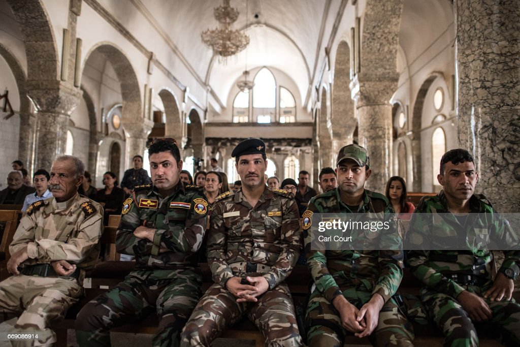 Iraqi Christian soldiers attend an easter ceremony at Saint John's Church (Mar Yohanna) in the nearly deserted predominantly Christian Iraqi town of Qaraqosh on April 16, 2017 near Mosul, Iraq. Qaraqosh was retaken by Iraqi forces in 2016 during the offensive to capture the nearby city of Mosul from Islamic State but it remains almost completely deserted.