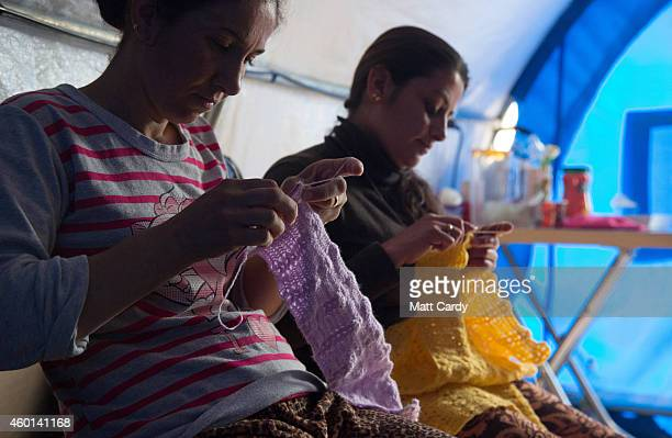 Iraqi Christian women knit jumpers for Christmas presents at a knitting club set up in a tent in the grounds of Mar Elias Catholic Church in Ankawa...