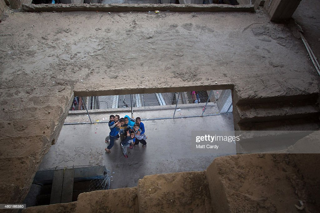 Iraqi Christians children, who fled from their homes because of Islamic State's advance earlier this year, pose for a photograph inside the unfinished Ankawa Shopping Mall which is now home to hundreds of displaced Iraqi Christians on December 8, 2014 in Erbil, Iraq. Although the autonomous Kurdistan region in northern Iraq was already a refuge for an estimated 250,000 Syrian refugees, since the Islamic State began its onslaught on Iraq in June, Kurdistan has also taken in a more than one and a half million displaced people. Many have been placed in purpose-built refugee camps but the huge numbers mean thousands of others are forced to live in un-finished buildings or inadequate, makeshift shelters and as winter in the region closes in, there are growing concerns for the welfare of the refugees who, while their homes are still in ISIL controlled territory, have no realistic prospect of returning to them.
