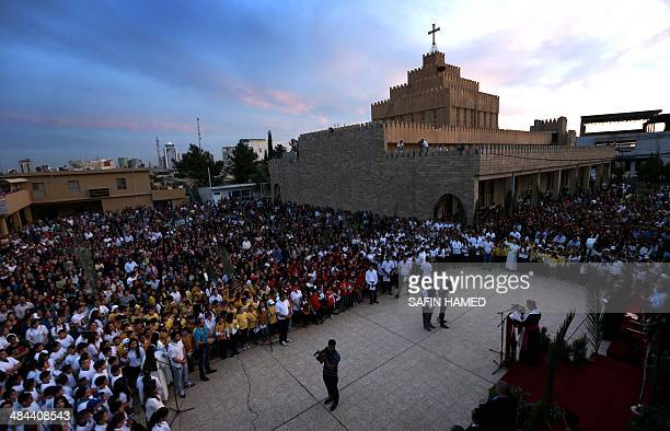 Iraqi Christians gather at St Joseph church in Arbil the capital of the autonomous Kurdish region of northern Iraq on April 12 to celebrate Palm...