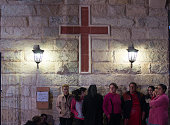 Iraqi Christians gather outside Mazar Mar Eillia Catholic Church that has now become home to hundreds of Iraqi Christians who were forced to flee...