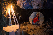 Iraqi Christians light candles inside a shrine in the grounds of Mazar Mar Eillia Catholic Church that has now become home to hundreds of Iraqi...