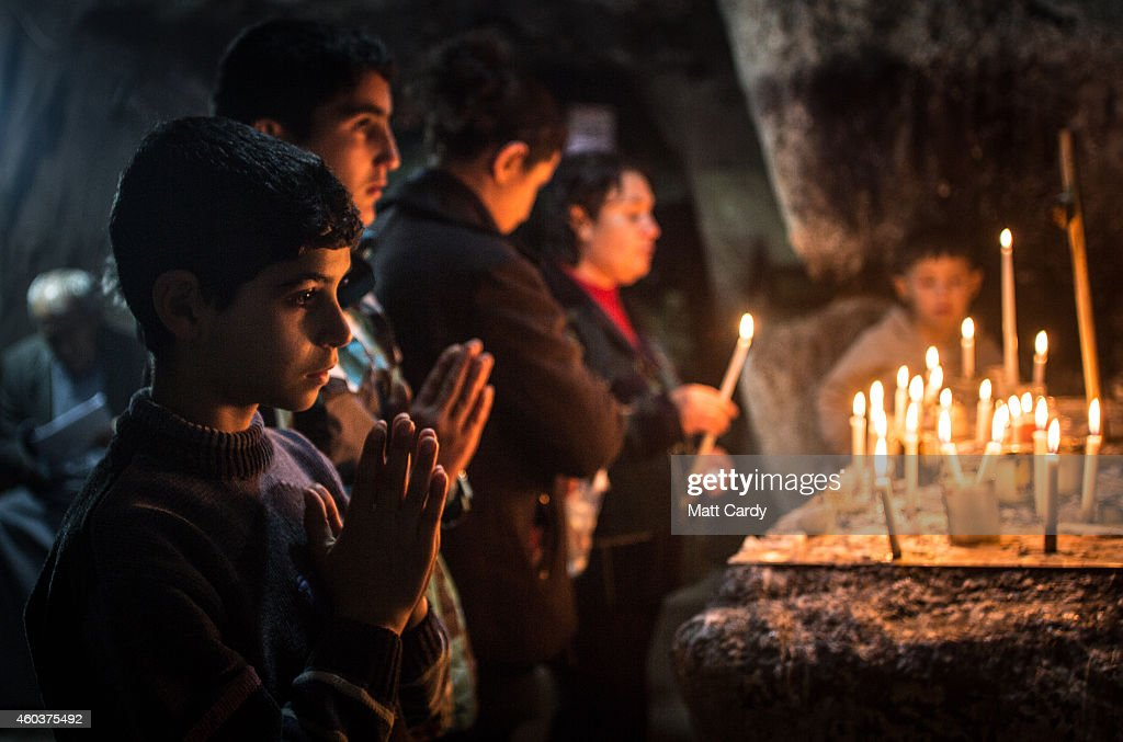 Iraqi Christians light candles inside a shrine in the grounds of Mazar Mar Eillia (Mar Elia) Catholic Church, that has now become home to hundreds of Iraqi Christians who were forced to flee their homes as the Islamic State advanced earlier this year, on December 12, 2014 in Erbil, Iraq. Although the autonomous Kurdistan region of Northern Iraq was already a refuge for an estimated 250,000 Syrian refugees, since the Islamic State began its onslaught on Iraq in June, Kurdistan has also taken in a more than one and a half million displaced people. Many have been placed in purpose-built refugee camps but the huge numbers mean thousands of others are forced to live in un-finished buildings or inadequate, makeshift shelters and as winter in the region closes in, there are growing concerns for the welfare of the refugees who, while their homes are still in ISIL controlled territory, have no realistic prospect of returning to them. Although the autonomous Kurdistan region in northern Iraq was already a refuge for an estimated 250,000 Syrian refugees, since the Islamic State began its onslaught on Iraq in June, Kurdistan has also taken in a more than one and a half million displaced people. Many have been placed in purpose-built refugee camps but the huge numbers mean thousands of others are forced to live in un-finished buildings or inadequate, makeshift shelters and as winter in the region closes in, there are growing concerns for the welfare of the refugees who, while their homes are still in ISIL controlled territory, have no realistic prospect of returning to them.
