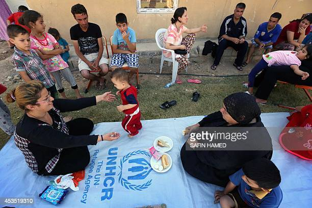 ASSIR Iraqi Christians who fled with their families the violence in Iraq's largest Christian town of Qaraqosh eat in the garden of Ainkawa's Saint...