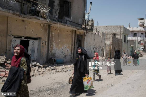 Iraqi civilians flee the Islamic State controlled Old City of west Mosul where heavy fighting continues on June 23 2017 Iraqi forces continue to...