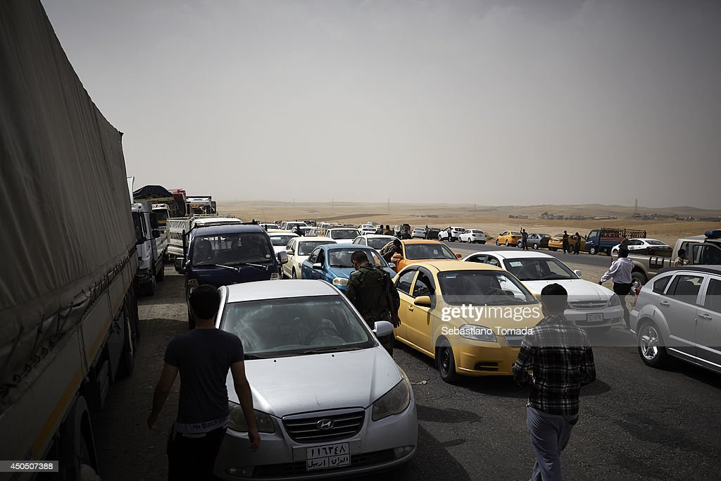 Iraqi civilians fleeing violence after ISIS militants have overrun part of the country, arrive at a Kurdish checkpoint.June 12, 2014.