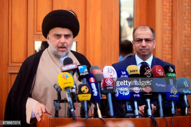 Iraqi cleric Moqtada Sadr speaks during a joint press conference with Iraq's parliament speaker Salim alJuburi in the central shrine city of Najaf on...