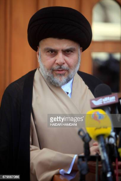 Iraqi cleric Moqtada Sadr speaks during a joint press conference with Iraq's parliament speaker in Iraq's central shrine city of Najaf on May 6...
