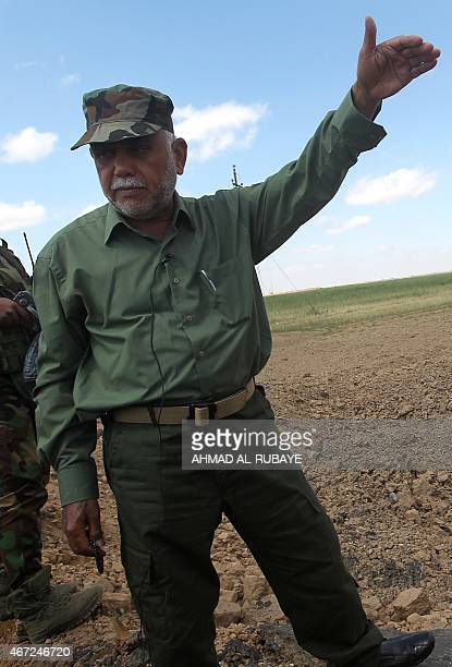 Iraqi commander of the Badr militia Hadi alAmeri stands in the AlAlam area north of Baghdad on March 22 2015 as he talks to the media about the...