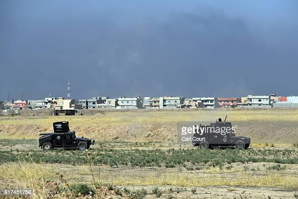 Iraqi counter terrorism Humvees drive past Bartella during the offensive to recapture the city of Mosul from Islamic State militants on October 23...
