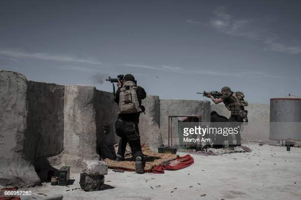 Iraqi Counter Terrorism Service soldiers fire at Islamic State fighters in Al Yarmuk west Mosul April 10 2017 The ICTS retook the district Iraqi...