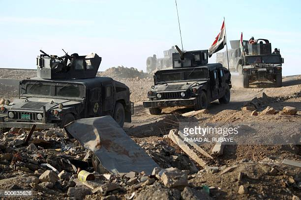 Iraqi counterterrorism forces drive in the Tameem district of Ramadi a large city on the Euphrates 100 kilometres west of Baghdad on December 9 2015...