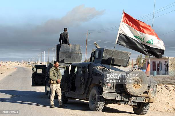 Iraqi counterterrorism forces look on ahead of entering the Tameem district of Ramadi a large city on the Euphrates 100 kilometres west of Baghdad on...