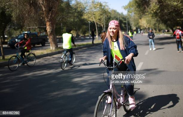 Iraqi cyclist Durra Ahmed arrives for a gathering during the second Baghdad Marathon for Peace in Iraq in the Iraqi capital Baghdad on February 4...