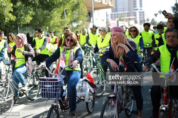 Iraqi cyclist Durra Ahmed gathers with other cyclists during the second Baghdad Marathon for Peace in Iraq in the Iraqi capital Baghdad on February 4...