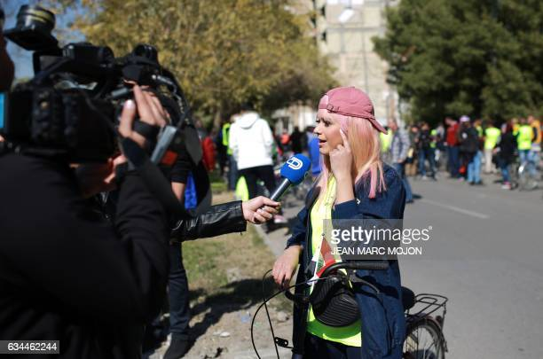 Iraqi cyclist Durra Ahmed speaks to the press during the second Baghdad Marathon for Peace in Iraq in the Iraqi capital Baghdad on February 4 2017...