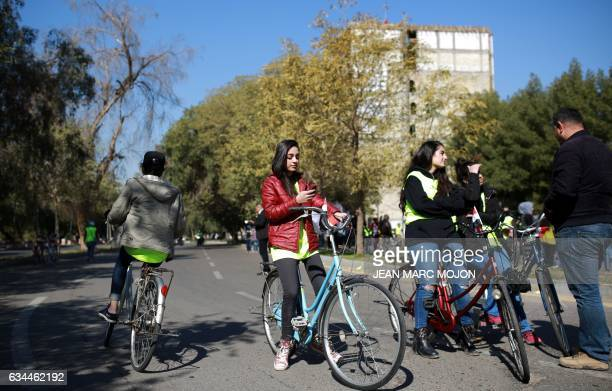 Iraqi cyclists gather during the second Baghdad Marathon for Peace in Iraq in the Iraqi capital Baghdad on February 4 2017 Marina Jaber a young...
