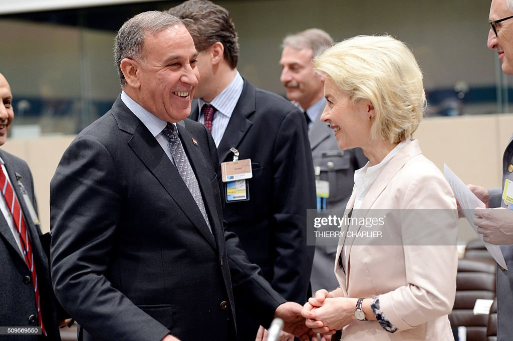 Iraqi Defence Minister Khaled al-Obaidi (L) speaks with his German counterpart Ursula von der Leyen prior to the start of the Global Coalition meeting against the Islamic State group IS held at NATO headquarter in Brussels on February 11, 2016. / AFP / THIERRY CHARLIER