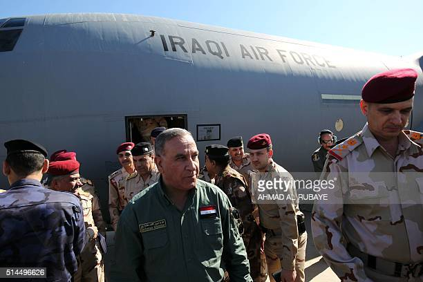 Iraqi Defence Minister Khaled alObeidi arrives to the Speicher military base in the Salaheddin province to visit volunteers from Mosul who are taking...