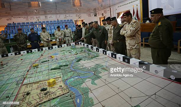 Iraqi Defence Minister Khaled alObeidi gives the detail of an operation on the map as he visits military units in Taci District of Saladin Iraq on...