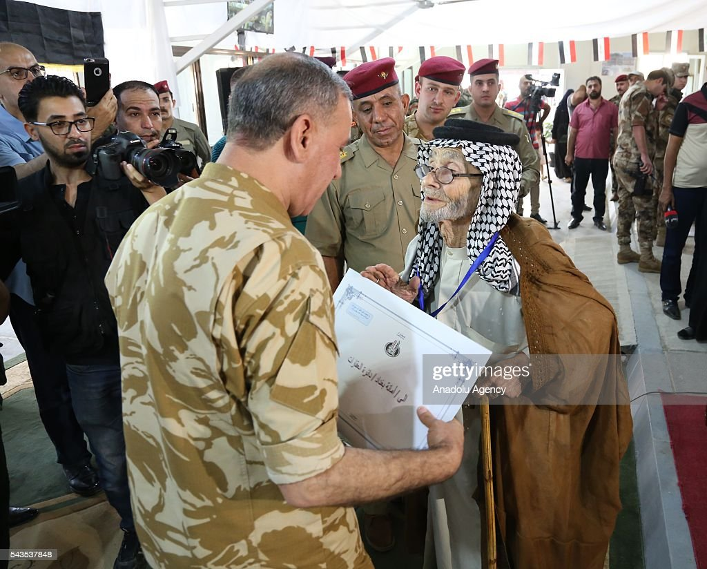 Iraqi Defense Minister Khaled al-Obaidi presents certificates to martyrs' relatives during his visit at Military Martyrs and Retirees Department in Baghdad, Iraq on June 29, 2016.