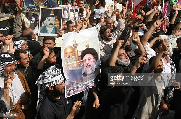 Iraqi demonstrators carry pictures of dead Iraqis and mock coffins during a protest March 8 2007 in the Iraqi city of Basra 340 miles south of...