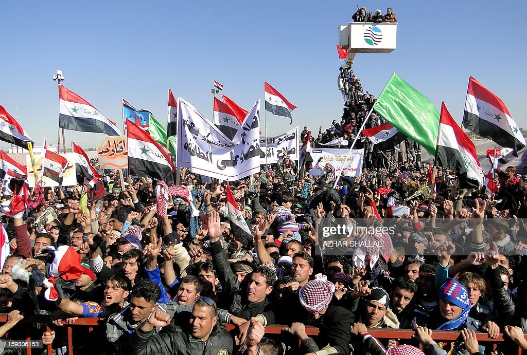 Iraqi demonstrators shout slogans during an anti-government protest in the western city of Ramadi on January 11, 2013. Thousands of Sunni Muslims took to the streets of Baghdad and other parts of Iraq to decry the alleged targeting of their minority, in rallies hardening opposition to the country's Shiite leader. AFP PHOTO/AZHAR SHALLAL