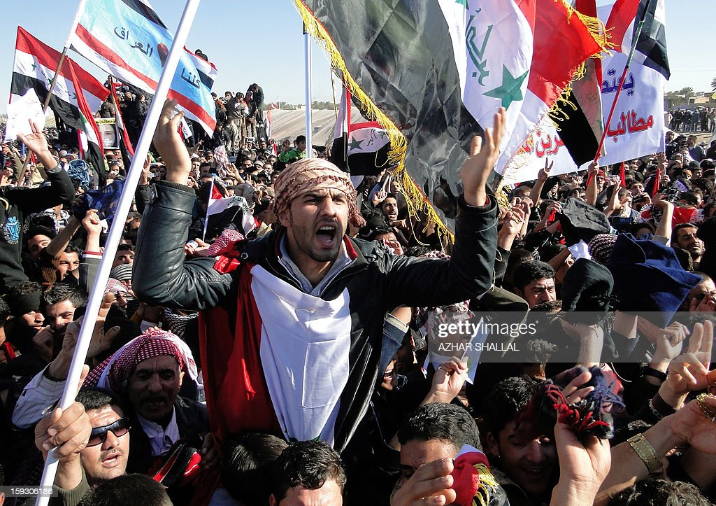 Iraqi demonstrators shout slogans during an anti-government protest in the western city of Ramadi on January 11, 2013. Thousands of Sunni Muslims took to the streets of Baghdad and other parts of Iraq to decry the alleged targeting of their minority, in rallies hardening opposition to the country's Shiite leader.